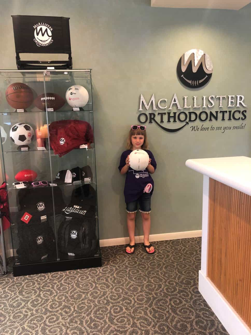 Rewards winner and prize case at McAllister Ortho